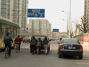 3 women pushing a broken down car Beijing China