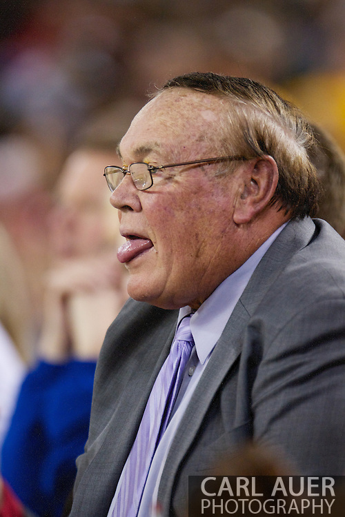 November 27th, 2010:  Anchorage, Alaska - St. John's Special Assistant and NCAA coaching legend Gene Keady sticks out his tongue in reaction to a call during the Red Storm's 67-58 victory against the Arizona State Sun Devil's to win the championship game of the Great Alaska Shootout.