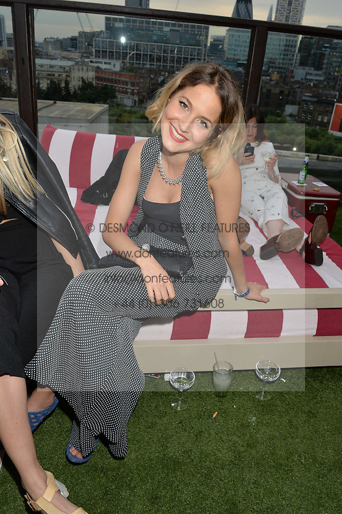 TESS WARD at the Warner Music Group & GQ Summer Drinks hosted in asociation with Quintessentially at Shoreditch House, Ebor Street, London on 6th July 2016.