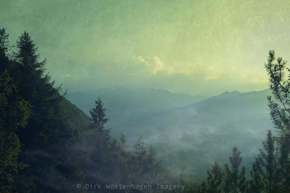 Rising mists over the valley Valmalenco in the Italian Alps near Chiareggio - textured photograph