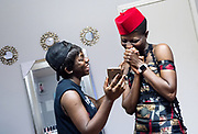 Designer Jacqueline Addison, left, owner of Akua Gabby, shows model Setor Nyendu a video of Nyendu walking in a new dress made by Addison during a fitting at Addison's studio in Northeast Minneapolis.