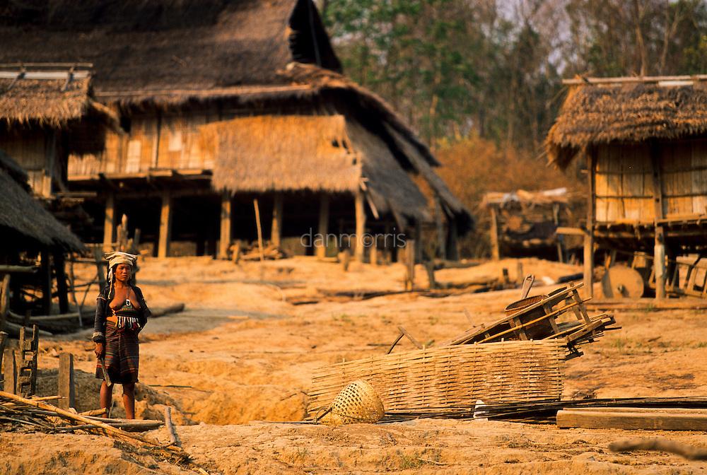 Akha Hill Tribe Woman cuts bamboo, Muang Singh, Laos