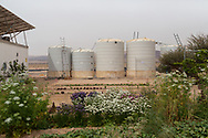 Desalinated water storage tanks at The Sahara Forest Project on the outskirts of Aqaba, on Jordan's southern Red Sea coastline. The farm uses desalinated sea water and greenhouses to sustainably farm crops in land that was once aris desert.