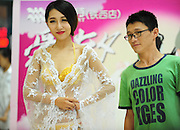 SHENYANG, CHINA - AUGUST 20: (CHINA OUT) <br /> <br />  golden underwear valued at $600,00<br /> <br /> A model showcases a set of golden underwear at a shopping mall on traditional Qixi Festival on August 20, 2015 in Shenyang, Liaoning Province of China. It\'s said that this set of underwear is hand-made in four kilograms and it values 4,000,000 RMB (about 625,229 USD). <br /> ©Exclusivepix Media