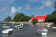 The red roofed church at Cap Malheureux on the northwest coast of Mauritius.  The Indian Ocean