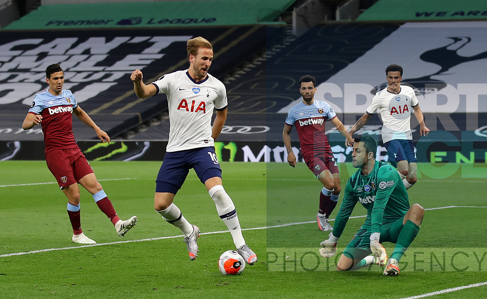 Harry Kane of Tottenham forces a save from Lukasz Fabianski of West Ham United during the Premier League match at the Tottenham Hotspur Stadium, London. Picture date: 23rd June 2020. Picture credit should read: David Klein/Sportimage