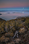 Full moon rising over Mono Lake in the evening, Mono County, Eastern Sierra, California
