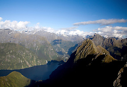 Southland District:  Aerial views of Milford Sound in Fiordland National Park, with Mitre Peak in the left foreground.