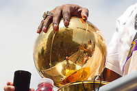 21 June 2010: Kobe Bryant of the Los Angeles Lakers holds the Larry O'Brien NBA Championship Trophy while wearing his 2009 championship ring during the Lakers Championship Victory Parade on Figueroa BL. in Los Angeles, CA after the Lakers won the 2010 NBA Championship over the Boston Celtics in Game 7 of the NBA Finals.