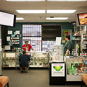 Jesse Rodriguez, left, a budtender, helps a customer on the medical side of the store at Medicine Man dispensary in Denver.