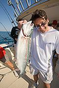 Todd Truttmann shows off his catch on a charter fising trip on Lake Michigan. (Mike Roemer Photo)