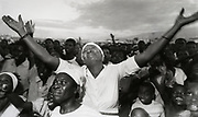 A Haitian woman shows her support of Mayoral candidate Franck Romain during the second political rally held by the candidate 14 January, 1988 in Port au Prince, Haiti.<br /> Shot with Nikon F3 camera and Nikkor 24mm F/2.8 lens.