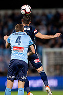 SYDNEY, AUSTRALIA - MAY 12: Melbourne Victory forward Kosta Barbarouses (9) heads the ball ahead of Sydney FC defender Alex Wilkinson (4) at the Elimination Final of the Hyundai A-League Final Series soccer between Sydney FC and Melbourne Victory on May 12, 2019 at Netstrata Jubilee Stadium in Sydney, Australia. (Photo by Speed Media/Icon Sportswire)