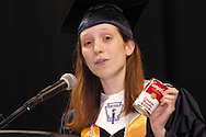 United student body treasurer Melanie West uses props as she speaks during the 29th annual Kettering Fairmont High School commencement at the Nutter Center in Fairborn, Thursday, May 31, 2012.