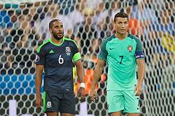 LYON, FRANCE - Wednesday, July 6, 2016: Wales' captain Ashley Williams and Portugal's captain Cristiano Ronaldo during the UEFA Euro 2016 Championship Semi-Final match at the Stade de Lyon. (Pic by David Rawcliffe/Propaganda)