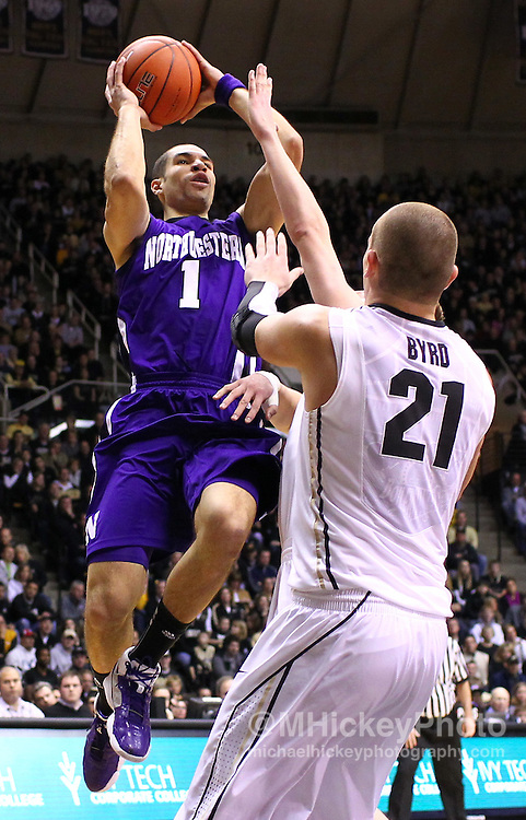 Feb. 12, 2012; West Lafayette, IN, USA; Northwestern Wildcats guard/forward Drew Crawford (1) shoots the ball against Purdue Boilermakers guard/forward D.J. Byrd (21) at Mackey Arena. Purdue defeated Northwestern 87-77. Mandatory credit: Michael Hickey-US PRESSWIRE
