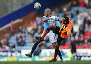 Chris O'Grady, Brighton striker and Alex Baptiste, Blackburn Rovers defender during the Sky Bet Championship match between Blackburn Rovers and Brighton and Hove Albion at Ewood Park, Blackburn, England on 21 March 2015.
