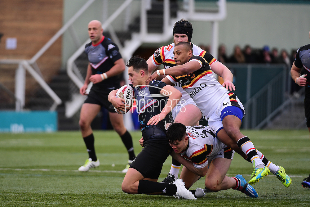 Bradford Bulls Johnny Campbell (19) puts in tackle with Bradford Bulls loose forward James Bentley (20) during the Kingstone Press Championship match between London Broncos and Bradford Bulls at Trailfinders Sports Club, Vallis Way, United Kingdom on 5 March 2017. Photo by Jon Bromley.