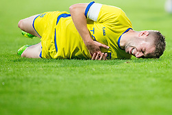 Nejc Skubic of Domzale injured during football match between NK Domzale and NK Celje in Round 2 of Prva Liga Telekom Slovenije 2014/15, on July 27, 2014 in Domzale, Slovenia. Photo by Vid Ponikvar / Sportida.com