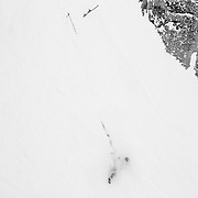 An unidentified skier explodes into Corbet's Couloir at Jackson Hole Mountain Resort.