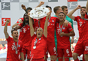 Bayern Munich's Dutch midfielder Arjen Robben, Bayern Munich's Brazilian defender Rafinha and 35 Renato SANCHES, 6 Thiago Alc&middot;ntara, Alcantara, 25 Thomas M&cedil;ller, Mueller  celebrate with he trophy  after the German First division Bundesliga football match FC Bayern Munich v Eintracht Frankfurt, <br /> MUNICH, 18. MAY 2019,  Fc BAYERN vs Eintracht FRANKFURT, 5:1 - Bundesliga Football Match, (L to R) Arjen Robben, Rafinha, Franck Ribery ,<br /> FcBayern Muenchen vs Eintracht FRANKFURT Bundesliga match at Allianz Arena on 18.05.2019, DFL REGULATIONS PROHIBIT ANY USE OF PHOTOGRAPHS AS IMAGE SEQUENCES AND/OR QUASI-VIDEO - fee liable image, <br /> copyright &copy; ATP / Arthur THILL