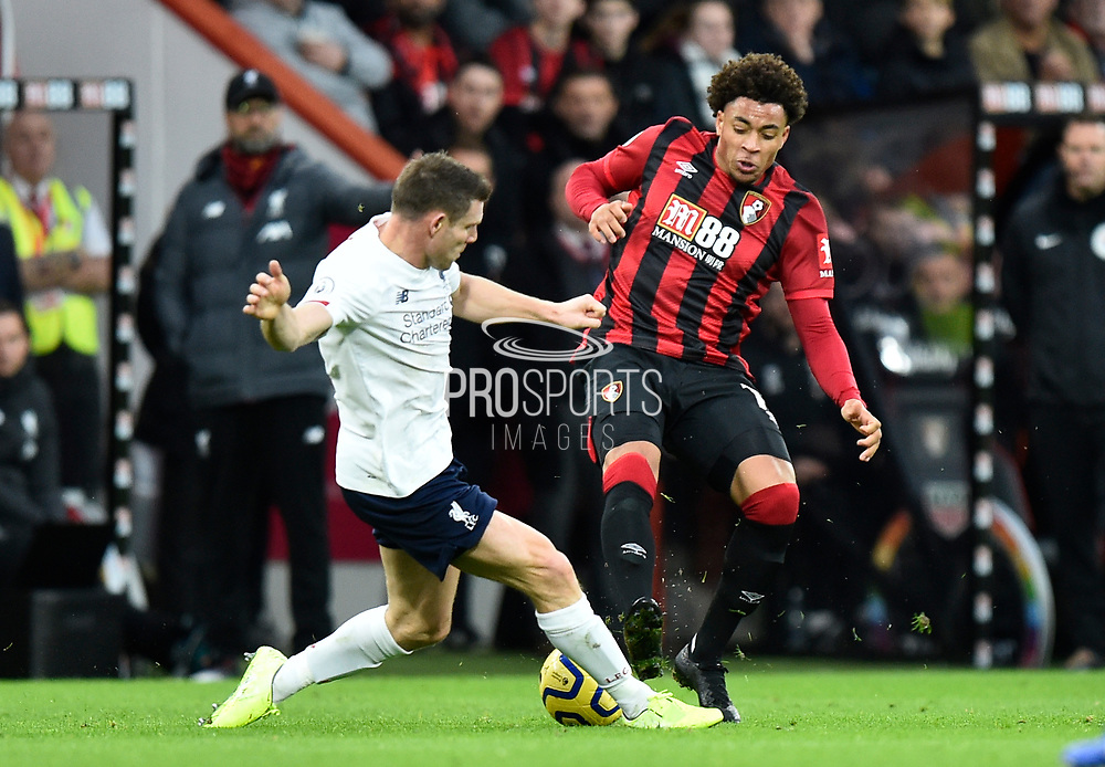 James Milner (7) of Liverpool challenges Arnaut Danjuma (14) of AFC Bournemouth during the Premier League match between Bournemouth and Liverpool at the Vitality Stadium, Bournemouth, England on 7 December 2019.