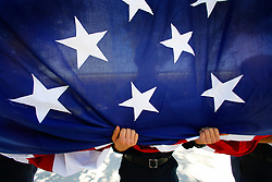 September 11, 2017 - San Diego, California, U.S. - Fire fighter STEVEN HAY, from San Diego County Fire, Cal Fire was one of four fire fighters that held a large U.S. flag as the ladder truck lifted the flag at the end of the ceremony following the 16th Anniversary Ceremony at Grossmont College. (Credit Image: © Nelvin C. Cepeda/San Diego Union-Tribune via ZUMA Wire)