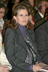 File photo - A pregnant Asma El Assad attends a symposium on 'Child Protection from Abuse and Neglet' directed by an NGO called 'Rainbow' in Damascus on 10 December 2004. Syrian First Lady is likely to be 7-8 months pregnant, just as her neighbour country leader Queen Rania of Jordan, even if the Syrian presidential family usually do not announce events such as birth or pregnancy considering them as 'private events'. Syria's British-born first lady Asma Assad has begun treatment for breast cancer. The Syrian presidency posted on its Facebook page a photo of President Bashar Assad sitting next to his wife in a hospital room. Photo by Balkis Press/ABACA.