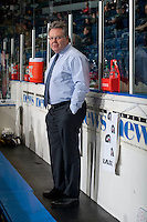 KELOWNA, CANADA - OCTOBER 25: Head coach Kelly McCrimmon of Brandon Wheat Kings stands on the bench during warm up at the Kelowna Rockets on October 25, 2014 at Prospera Place in Kelowna, British Columbia, Canada.  (Photo by Marissa Baecker/Getty Images)  *** Local Caption *** Kelly McCrimmon;