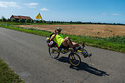 Ligfietsers rijden door de polder bij Haamstede.<br /> <br /> Recumbent cyclists ride at the polder near Haamstede.