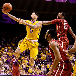 Jan 30, 2016; Baton Rouge, LA, USA; LSU Tigers guard Josh Gray (5) shoots over Oklahoma Sooners forward Dante Buford (21) during the first half of a game at the Pete Maravich Assembly Center. Mandatory Credit: Derick E. Hingle-USA TODAY Sports