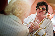 Aug. 2 - PHOENIX, AZ: DONALD TRAPANI, dressed as Elvis Presley, greets a fan after a show at The Stratford, an Alzheimer's care facility in Phoenix, AZ. Trapani, 68, was diagnosed with lung cancer in August 2009 and entered the care of Hospice of the Valley, the largest hospice organization in Phoenix, shortly after that. His doctor said he would be dead by the end of February 2010. Trapani is in still in the care of Hospice of the Valley, but his condition has improved. He now entertains other hospice patients singing the songs of Elvis Presley. He tries to hold one concert each week, his health permitting, at different hospice units in the Phoenix area.     Photo by Jack Kurtz