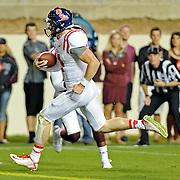 Mississippi quarterback Bo Wallace (14) runs in to the end zone for a touchdown during the first half of an NCAA college football game against Texas A&M in College Station, Texas, Saturday, Oct. 11, 2014. (Photo/Thomas Graning)
