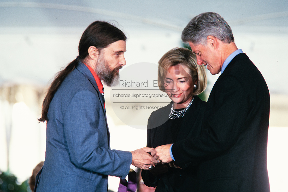 Jean Louis Bourgeois accepts the National Medal of Arts award on behalf of his mother; sculpture Louise Bourgeois from President Bill and Hillary Clinton during a ceremony on the South Lawn of the White House September 29, 1997 in Washington, DC. After accepting the medal Bourgeois gave it to President Bill Clinton as a gift.
