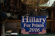 """A """"Hillary For Prison 2016"""" sign on display at Kitchens Hardware & Deli in Mineola, Texas on March 8, 2016. (Cooper Neill for The New York Times)"""