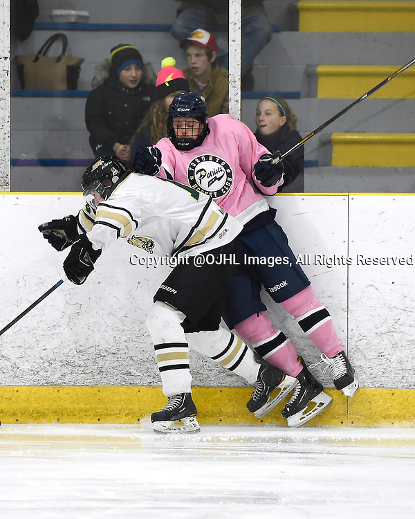TORONTO, ON - Nov 29, 2014 : Ontario Junior Hockey League game action between Cobourg and Toronto Lakeshore, Spencer Holt #14 of the Cobourg Cougars makes the hit on Tyler Currie #4 of the Toronto Patriots during the second period.<br /> (Photo by Andy Corneau / OJHL Images)