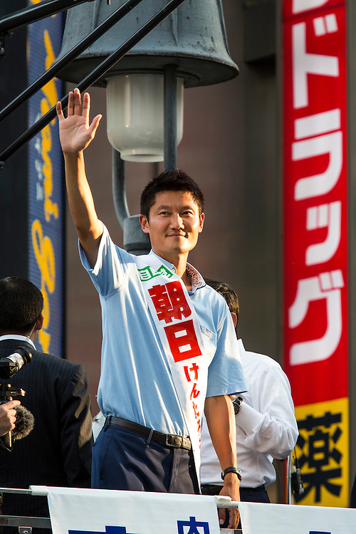 TOKYO, JAPAN - JULY 03 : Candidate Kentaro Asahi of Liberal Democratic Party (LDP) waves to supporters during the Upper House election campaign in Shibuya crossing, Tokyo prefecture, Japan, on July 3, 2016. (Photo by Richard Atrero de Guzman/ANADOLU AGENCY)