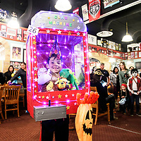 Thomas Segura, 9, participates in a costume contest at Sammy C's Rockin Sports Pub & Grille on Halloween. Segura won first place in the costume contest as a claw machine he made himself.
