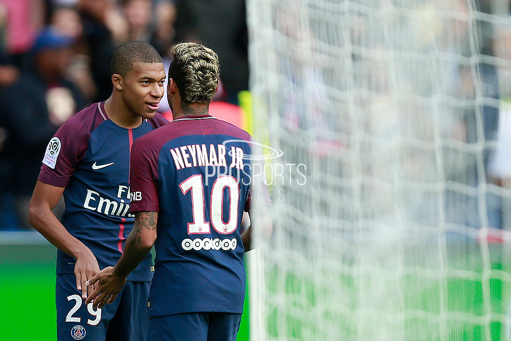 Paris Saint Germain's French forward Kylian Mbappe celebrates after scoring with Paris Saint Germain's Brazilian forward Neymar Jr during the French Championship Ligue 1 football match between Paris Saint-Germain and Girondins de Bordeaux on September 30, 2017 at the Parc des Princes stadium in Paris, France - Photo Benjamin Cremel / ProSportsImages / DPPI