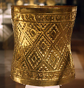 Crown. Peru: Sican (Lambayeque) 9th-11th century.  Hammered gold. In the burial of a high-status Sican lord, archaeologists discovered 1.2 tons of grave goods, including a large treasure box that held more than sixty ornaments of sheet gold. Most were head ornaments.