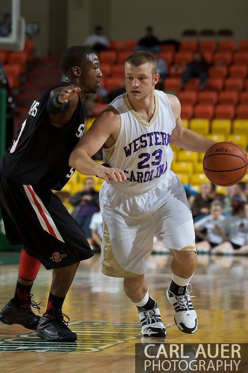 November 27, 2008: Western Carolina's Joey Parker (23) drives past San Diego State's Richie Williams in the final game in the opening round of the 2008 Great Alaska Shootout at the Sullivan Arena