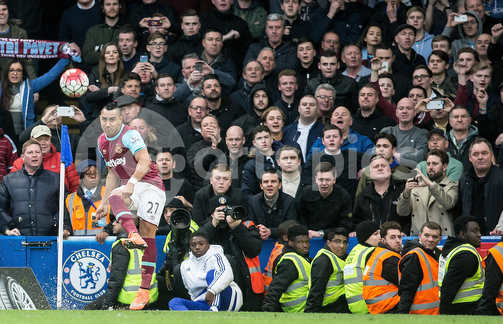 Dimitri Payet of West Ham United takes a corner eagarly watched by West Ham fans during the Barclays Premier League match between Chelsea and West Ham United at Stamford Bridge, London, England on 19 March 2016. Photo by Steve Ball.