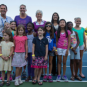August 19, 2014, New Haven, CT:<br /> Connecticut Lieutenant Governor Nancy Wyman and Coco Vandeweghe pose for a photograph with kids during a Girl Scout Night clinic on day five of the 2014 Connecticut Open at the Yale University Tennis Center in New Haven, Connecticut Tuesday, August 19, 2014.<br /> (Photo by Billie Weiss/Connecticut Open)
