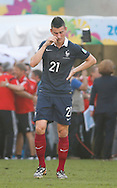Laurent Koscielny of France wipes his face after losing 0-1 during the 2014 FIFA World Cup match between France and Germany at the Maracana Stadium, Rio de Janeiro<br /> Picture by Andrew Tobin/Focus Images Ltd +44 7710 761829<br /> 04/07/2014