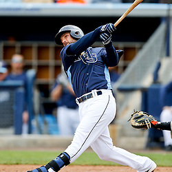 Mar 2, 2013; Port Charlotte, FL, USA; Tampa Bay Rays third baseman Ryan Roberts (19) hits a solo homerun off Baltimore Orioles starting pitcher Brian Matusz (not pictured) during the bottom of the fourth inning of a spring training game at Charlotte Sports Park. Mandatory Credit: Derick E. Hingle-USA TODAY Sports
