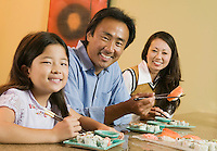 Family Eating Sushi Together portrait