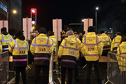 Security team minutes before gates are opened at  Edinburgh Hogmanay street party in the city on New Year's Eve. Scotland, United Kingdom.