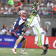 Matt Gibson #66 of the New York Lizards tries to get past Kyle Sweeney #77 of the Boston Cannons during the game at Harvard Stadium on July 19, 2014 in Boston, Massachusetts. (Photo by Elan Kawesch)