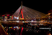Zakim Bridge and TD Gardens burning red in celebration of the Red Sox Winning the World Series oct 30, 2013
