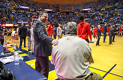 Jan 2, 2019; Morgantown, WV, USA; Texas Tech Red Raiders head coach Chris Beard talks with West Virginia Mountaineers head coach Bob Huggins before the game at WVU Coliseum. Mandatory Credit: Ben Queen-USA TODAY Sports